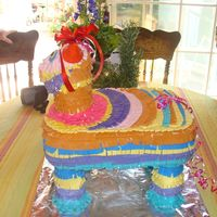 Pinata Cake  This was an idea from cake central that I fell in love by crazycakes.Vanilla 1/2 sheet cake with lemon mousse filling. The feet and head...