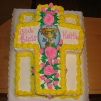 166.jpg   1/2 sheet vanilla cake with bc icingcut out cross cake on top