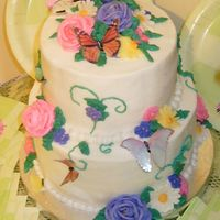Kelly's Butterfly Cake Each tier is one layer of strawberry cake and one layer of banana cake, with raspberry preserves in between. The icing is all buttercream,...