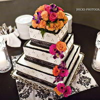 Black And White Wedding wasc cake.... black ribbon and silver dragees