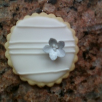 White And Silver Cookies Sugar rollouts with Toba's glace. RI lines and mmf flower painted silver with silver pearl dust mixed with vodka.