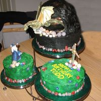 "Dragon And Wizard Birthday Cake   6"" Red Velvet, 8"" Milk Chocolate, and 10"" White cakes, iced in buttercream with royal icing and gumpaste accents."