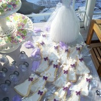 Wedding Dress Cookies wedding dress cookies, covered with fondant, bow is chocolate.
