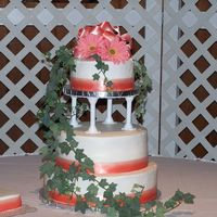 First Wedding Cake this is my first try at a tiered and stacked cake. It was also my first wedding cake. I don't think it turned out to bad. The top and...