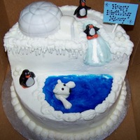 Polar Bear & Penguins Birthday I used three 8-inch layers to make this cake and half of a mini-ball cake. The cake is iced with b/c icing, I used gel for the pool of...