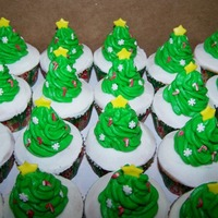 Christmas Tree Cupcakes Cupcakes made with B/C icing, the tree was also made with B/C icing and decorated with little candies and fondant.
