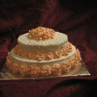 Roses, Roses, Roses Oval white layers with buttercream. Buttercream roses were made in advance and dried for ease of placement. I wanted to practice my rose-...