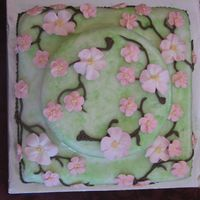 "Cherry Blossoms White cake w/ citrus rolled buttercream. This was the 1st and only time I used rolled buttercream. It seemed ""oily"" to me, but..."