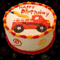 Fire Engine Cake This was a red velvet & yellow cake baked with the Wilton checkerboard cake pan set. The cake was iced with buttercream and blue...