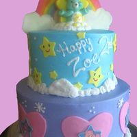 Care Bear Rainbows Birthday Cake I got some inspiration from different cakes on here as well as the party decor. The rainbow is colored candy melts, and the stars and heart...