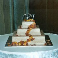 Weddingfallcakechrisjess1.jpg Fall square wedding cake. Fondant Fall leaves and fondant cranberries.
