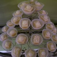 My First Petit Fours White chocolate ganache over yellow cake and buttercream rosettes. Thanks to LisaMS for her recipe!