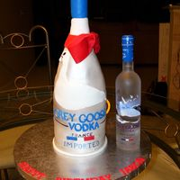 Grey Goose Vodka Cake covered in fondant and fondant accents. The bottle is all cake and the neck is fondant.