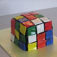 Rubik's Cube My daughter had an 80's theme bday party so I made her a Rubiks cube. The fondant squares started to slide a little in the heat. I...