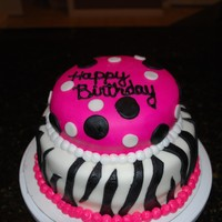 Hot Pink Zebra Cake Vanilla cake with strawberry filling covered in fondant with fondant decorations. This cake was so much fun to make
