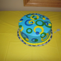 Fondant Circle Cake   This was for a baaby shower but I don't think it looks much like a baby shower cake. It was buttercream with fondant circles.