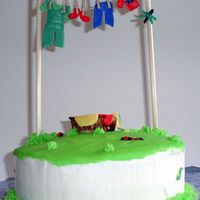 Clothesline Cake Vanilla cake with buttercream icing and MMF decorations. My second time modeling with MMF. All decorations are MMF. The clothes are...