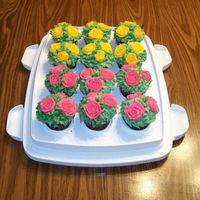 118357701795917.jpg An order based on my previous purple rose cupcakes. Chocolate Fudge Cupcakes with Cream Cheese Buttercream Frosting. Customer did not...