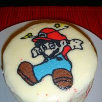 Mini Mario Cake  This is a practice cake. I wanted to try doing a transfer using buttercream frosting. The cake is about 4 inches wide and 3 1/2 inches tall...