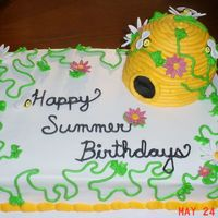 Summer Birthday Cake This cake was done for a church to celebrate everyone's birthday for the month. It is all cake with fondant flowers and bees.