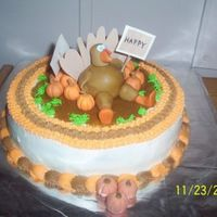Happy Thanksgiving Thanksgiving cake. Turkey & pig in pumpkin patch. I went w/ a turkey & a pig due to turkey/ham being main course.. LOL Turkey...