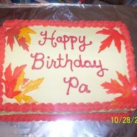Autumn Themed October Birthday Cake b/c icing, mmf leaves, french vanilla/yellow 2 layer cake. Was made for my Pa's 74th birthday. Fall theme, hubby picked maple leaves (...