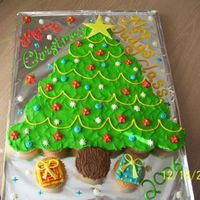Christmas Tree Ccc First ever cupcake cake. I had been wanting to make one.. I made this very last minute for sons' 1st grade party. (I ran into his...