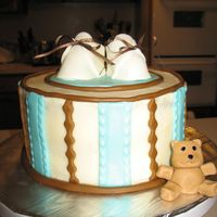 Baby Bootie Cake italian cream cake w/ cream cheese icing with mmf accents. the bear and booties are also made from mmf.