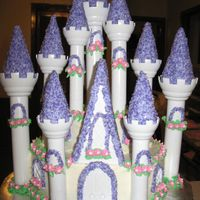 Princess Castle french vanilla cake w/ buttercream. This cake took a lot of time but the little girl loved it!