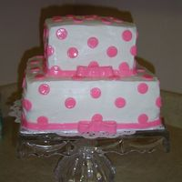 2 Layer Polka Dot Pink Cake I made this for a bridal shower for a girl at church. Turned out really cute.. The dots and ribbon are all made of fondant.