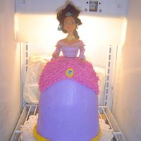 Jasmine From Aladdin Made this for my best friend's 3 yr. old daughter. Her hair looks kind of wierd becaues I had to pull it up until the icing dried.
