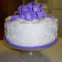 White Cake With Swirls And Purple Bow 2 Layer White cake frosted with Wilton's Decorating Icing and topped with a purple bow made from the MMF recipe from this site (very...