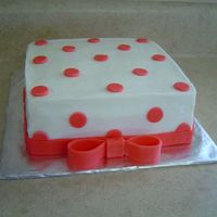 Polka Dot Cake I made this cake for a small bridal shower for a 20 year old. The dots and ribbon are made of fondant