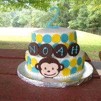 Mod Monkey I made this cake for a friend's son. Buttercream with candy clay accents. The monkey is a chocolate transfer. TFL!