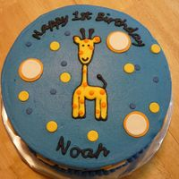 1St Birthday Giraffe Cake I made this for my good friend's son. It was made to match the invitation. Chocolate cake with oreo filling. Iced in butter cream with...