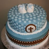 Baptism Cake I made this cake for my son's baptism. It is buttercearm with fondant accents and gumpaste booties. It matched the design of his...