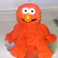 Elmo Cake This was a challenge gosh i am glad to be doen with this cake, What could go wrong did with this cake lol..The buttercream did not want to...