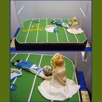 Touch Down!  Groom's cake for a San Diego Chargers fan. Ordered by father of bride, wanted to show Groom scoring a touch down by holding on to the...