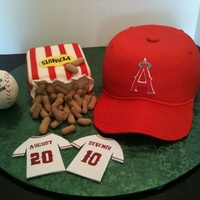 Angels' Baseball  This was for a wedding shower, where the engaged couple were huge Angels' fans. Cap and Peanuts Box are cake covered in fondant....