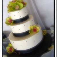 Elizabeth  Ivory buttercream, black fondant dots and satin ribbon. Orchids are real. Didn't have the time to make them, I also wasn't in the...