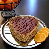 Chocolate-Orange Truffle Cake  Whipped this up for my sweetheart. It's a 2 layer, heart-shaped chocolate-orange truffle cake filled with orange marmalade. Crushed...