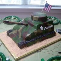 "Tank Cake  This cake was five layers: an 11x15, (2) 9x13, an 8"" square topped off with a 6"" round. I carved the cake into a tank shape and..."