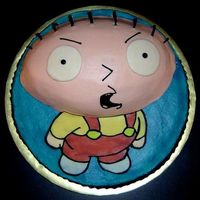 "Family Guy's Stewie Cake  This is a 14"" round with a football cake on top for Stewie's head. It's hard to see from above, but there's no top..."