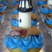 Lighthouse Cupcake Closeup of the lighthouse cupcakes. Molded candy lighthouses, candy rocks and brown sugar sand.