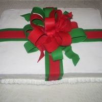 Christmas Gift I made this for my mother-in-law's birthday. It was my first time making a fondant bow and using fondant.