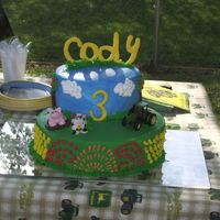 Farm/tractor Cake This was for my son's 3rd birthday; he absolutely loved it! It was my first time using gumpaste (used to make pig and cow). Also my...