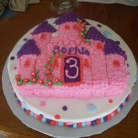 Castle Cake Wilton castle pan on top of 14 inch round cake. Friend wanted the bottom cake to have polka dots for the birthday girl!