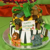 Safari Cake Thanks to Julie0902! This is a copy of her cake,. What a great design! Buttercream, fondant accents and animals.