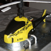 Remote Control Helicopter Cake fondant with fondant covered straws and fondant covered cardboard for propellers.chocolate cake with dirt cake filling,