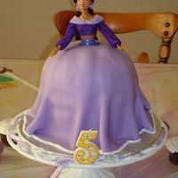 Princess Jasmine Cake Princess Jasmine Cake. Dress is covered in lavender fondant and dusted with pearl luster dust.